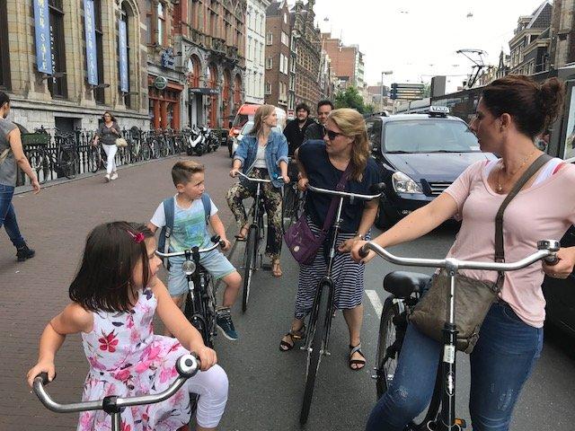 Kids cycling through Amsterdam - Bikes Amsterdam