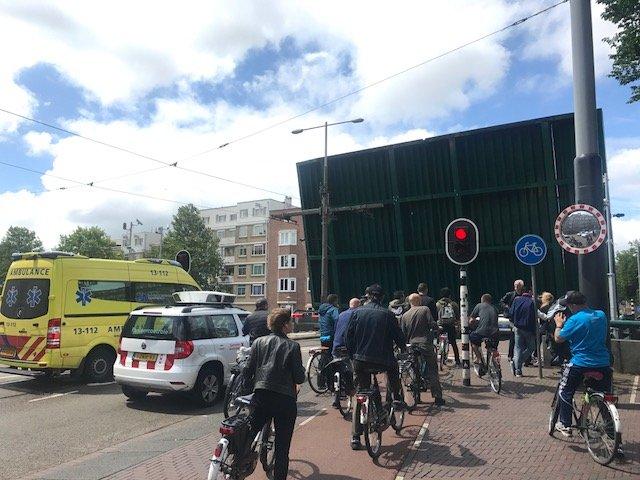 Bikers waiting for an open bridge - Bikes Amsterdam