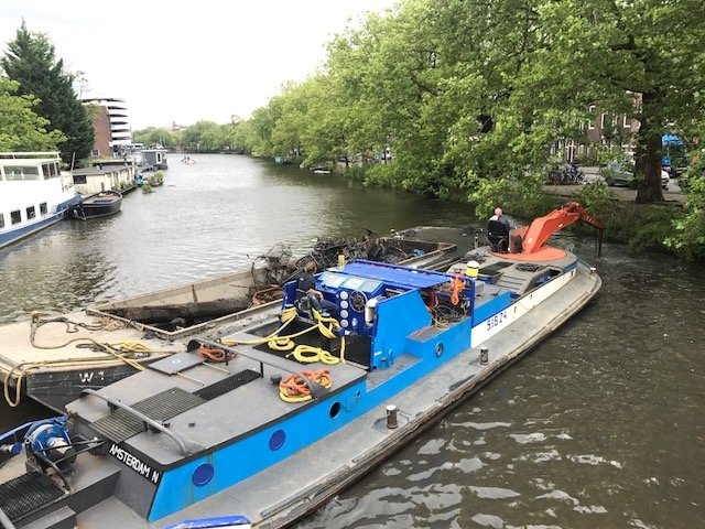 Waternet removing bikes from the canals in Amsterdam - Bikes Amsterdam