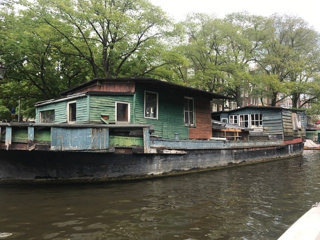 Houseboat looking like it needs maintenance