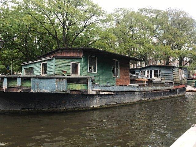 Houseboat looking like it needs maintenance