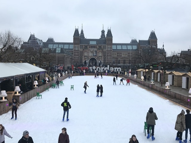 Ice skating on Museumsquare in Amsterdam during winter time