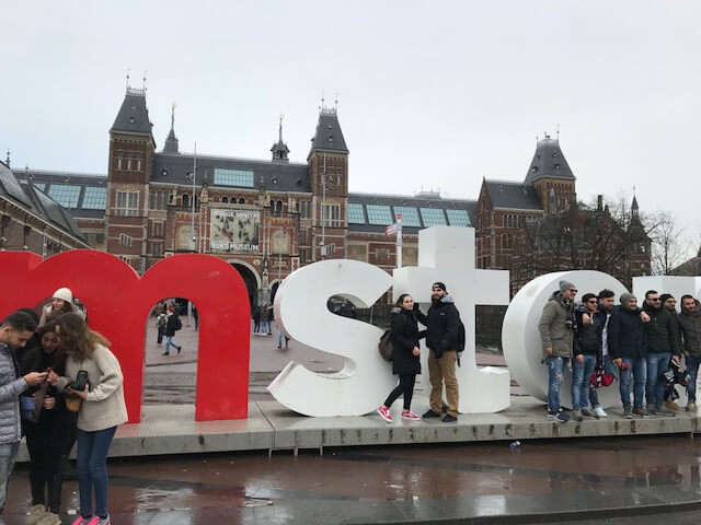 Taking a picture in front of the IAmsterdam Sign
