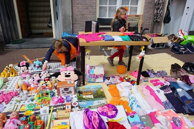 Little kids selling their stuff on Kingsday in Amsterdam