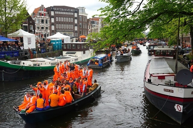 Prinsengracht Orange boat during Kingsday Amsterdam