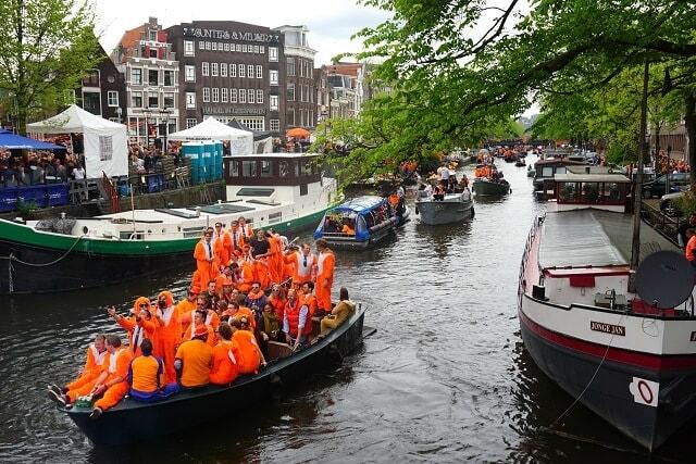 Prinsengracht Orange boat during Kingsday Amsterdam