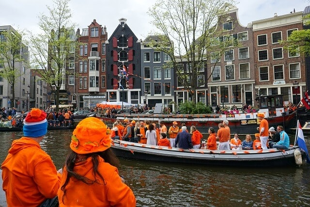 People in Orange on boats during Kingsday