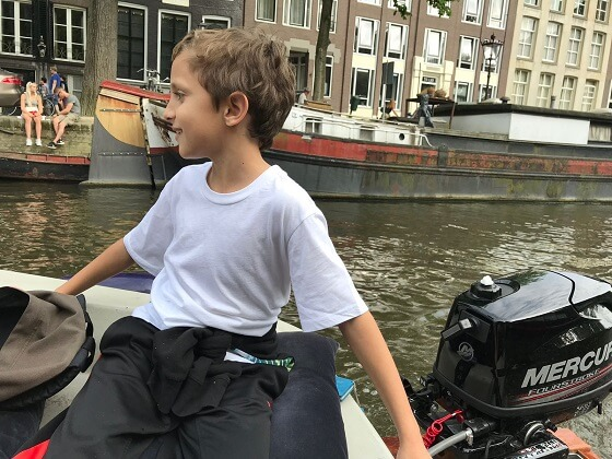 Gabriel steering the boat